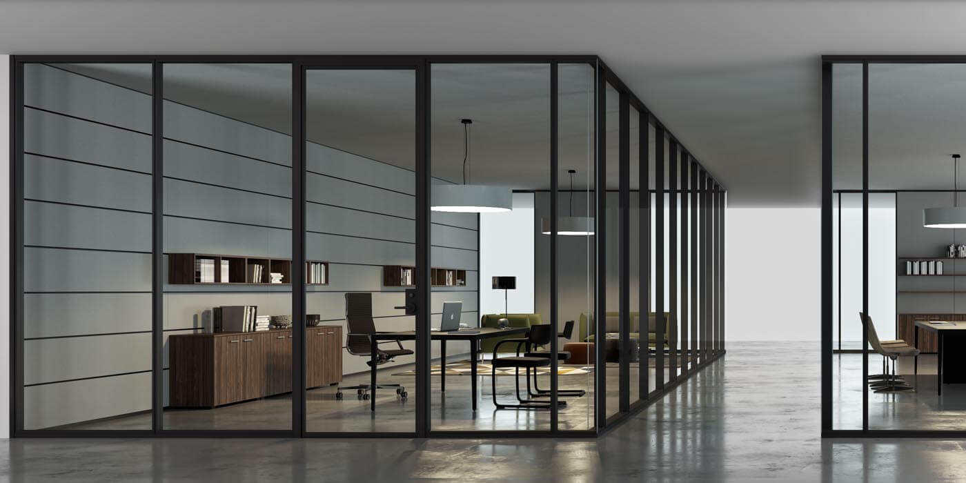 Two large workspaces surrounded by floor to ceiling interior glass wall systems separated by a hallway