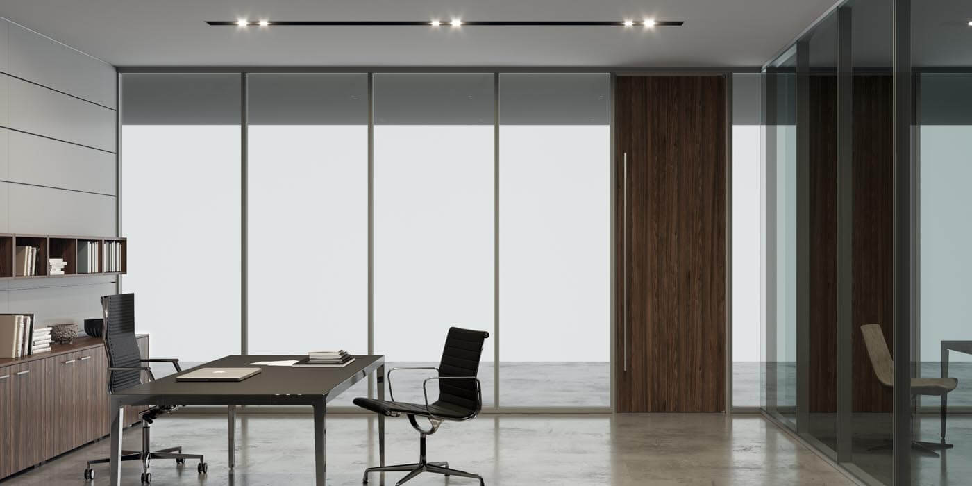Floor to ceiling glass wall system seamlessly installed to the ceiling grids to create a corporate office space.