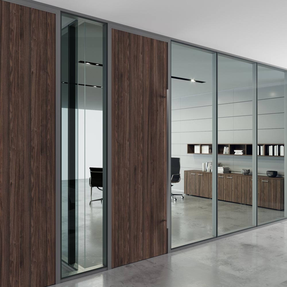 Five BRIDGE modular glass wall panels in glass and wood finish for a textured office aesthetic.