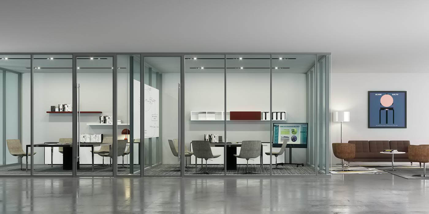 Three workspaces separated by by floor to ceiling Transwall interior glass wall systems