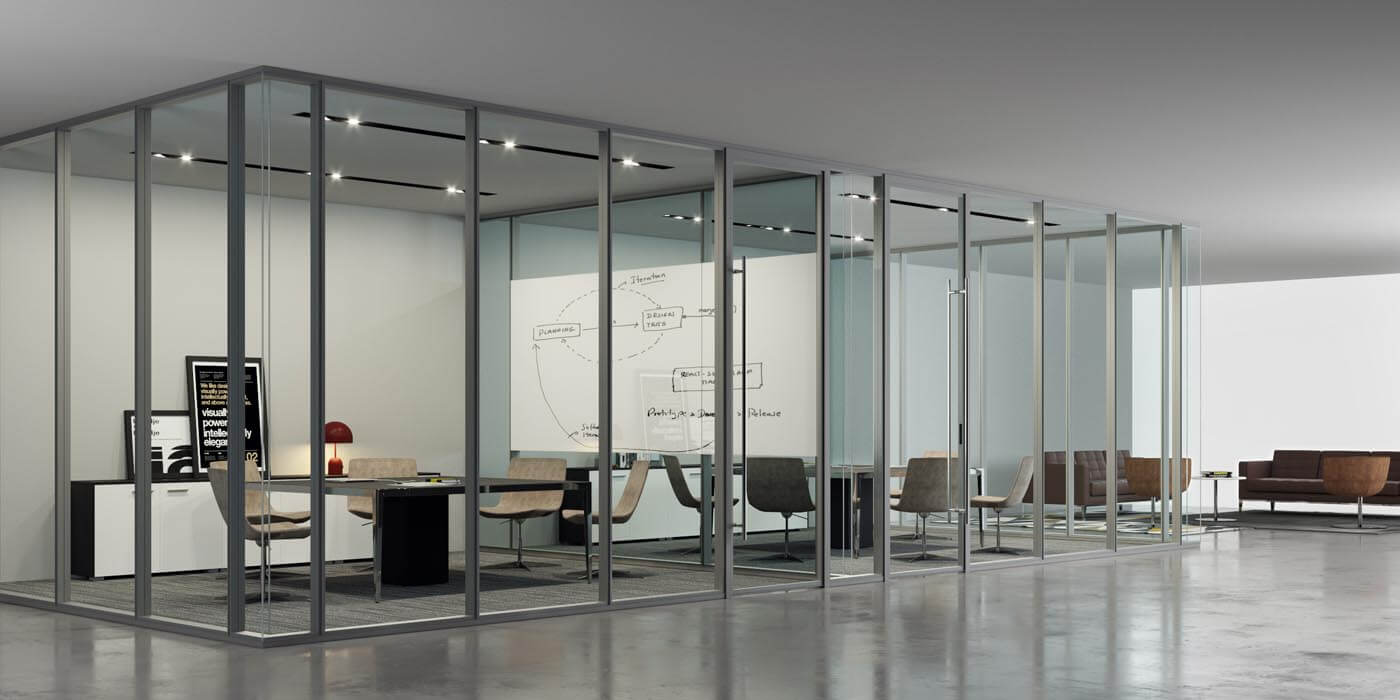 Floor to ceiling glass office walls create two small conference rooms in an open floor plan