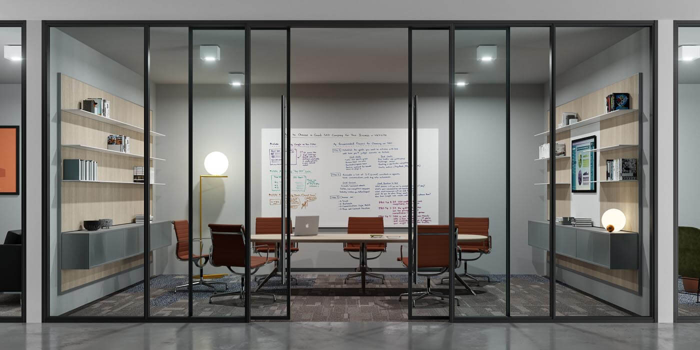 Conference room with large whiteboard and BRIDGE sliding glass wall system and black trim.
