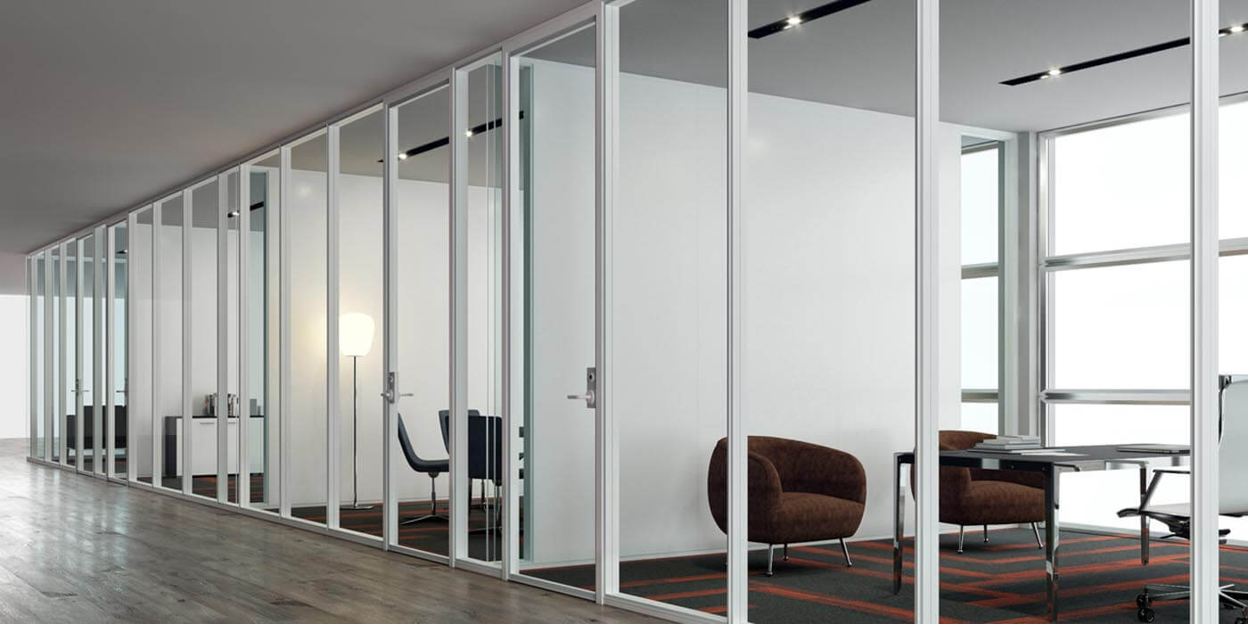 Office building hallway with BRIDGE interior glass wall systems and ample light installed by Transwall