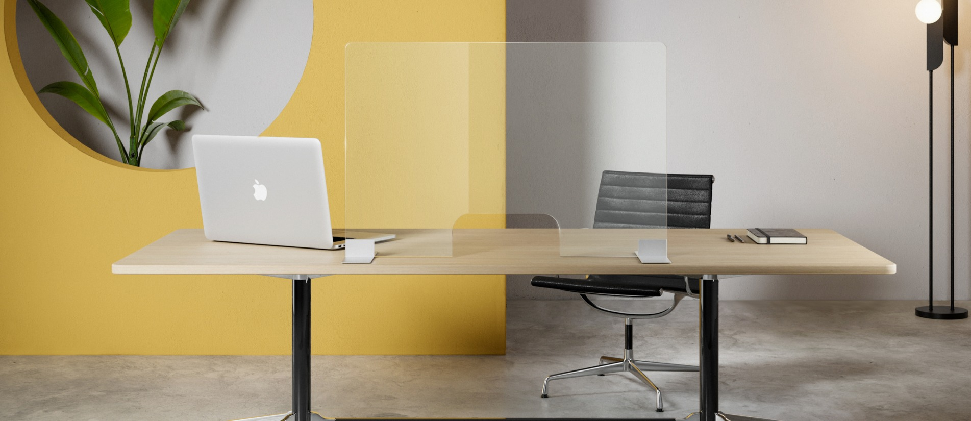 Free standing glass panel desk divider in an bright yellow colored office