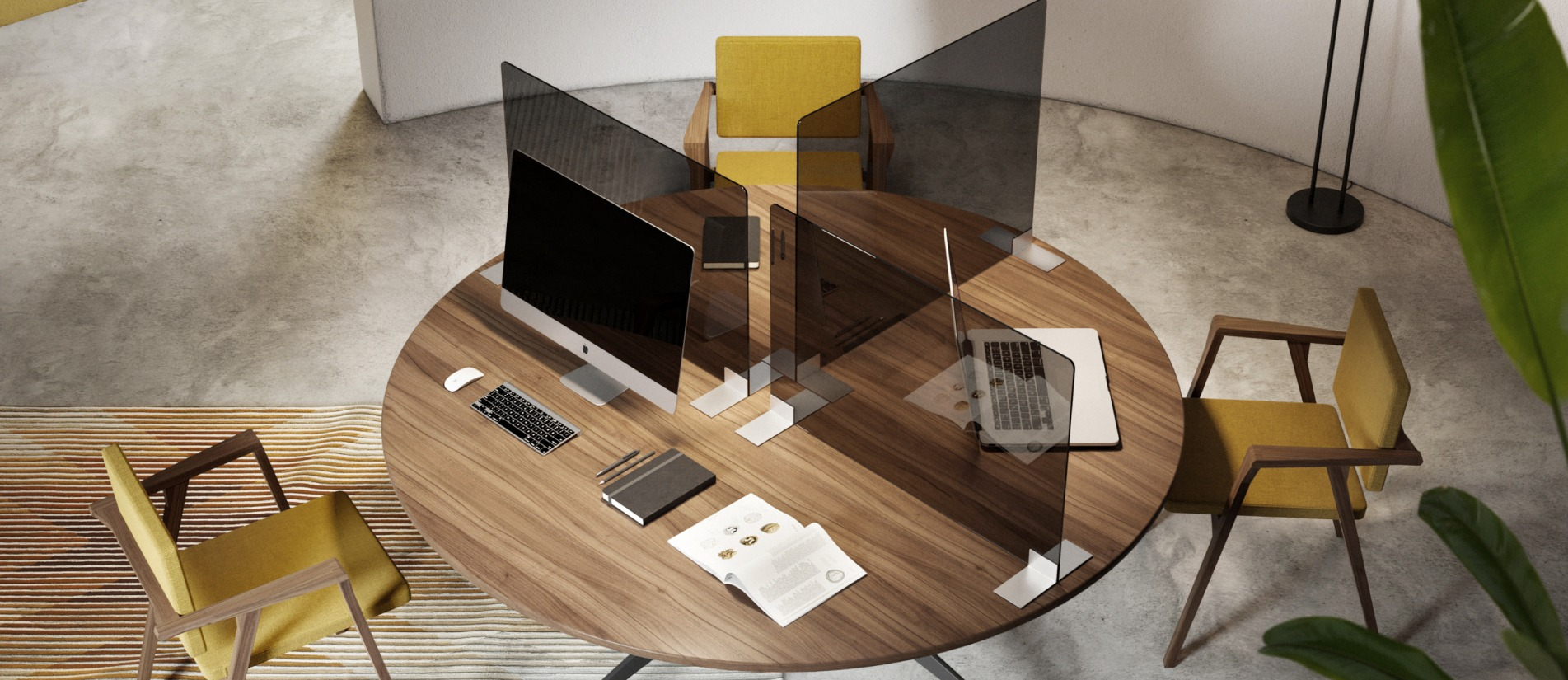 Office computers at a desk with three tabletop desk divider panels by Transwall