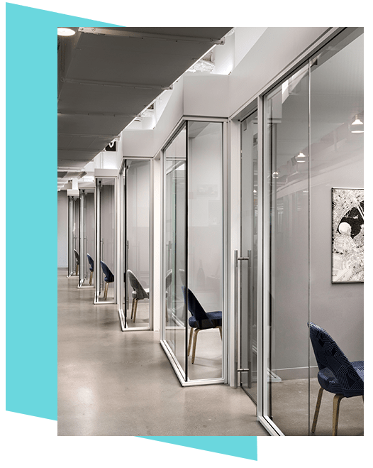 Hallway of offices designed with Transwall One LP flexible office wall system