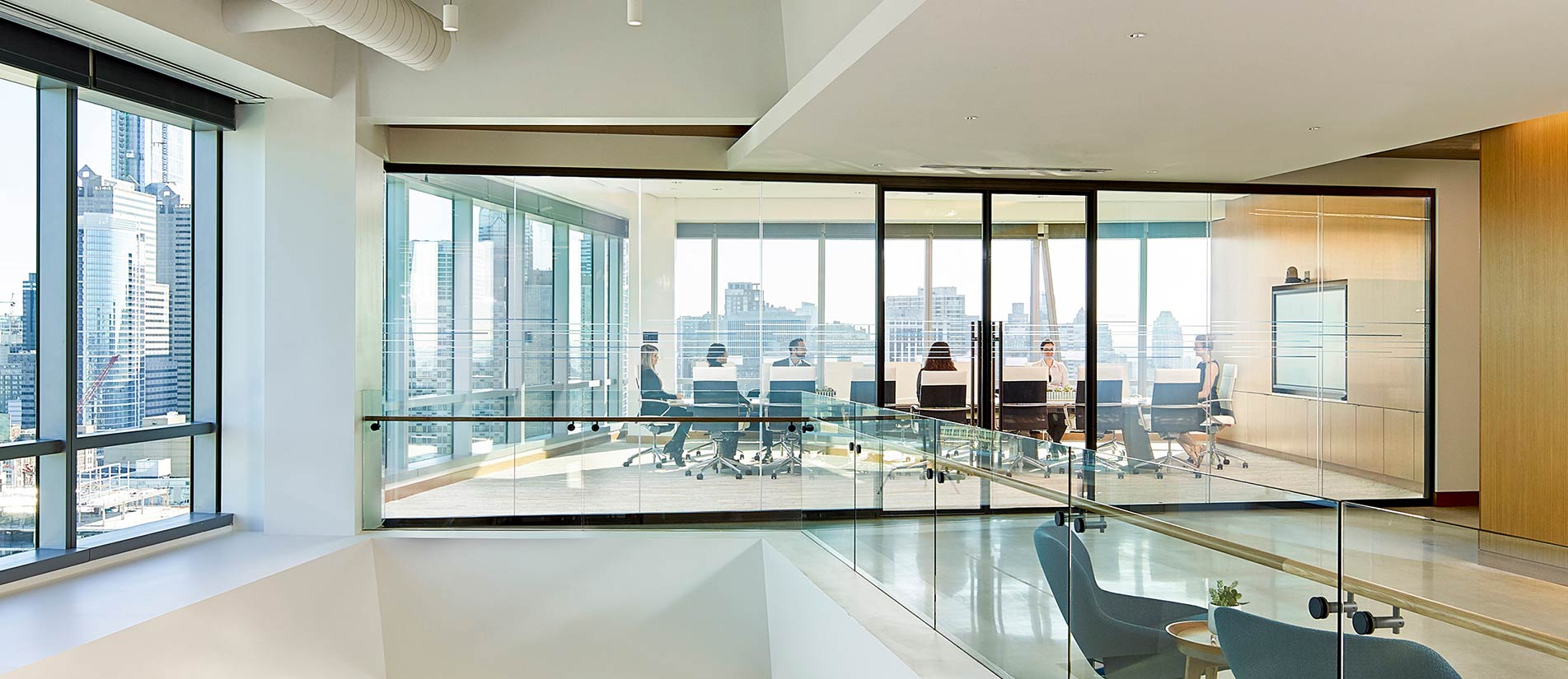 A double-glazed wall system creating a conference room with an overlooking view of the city