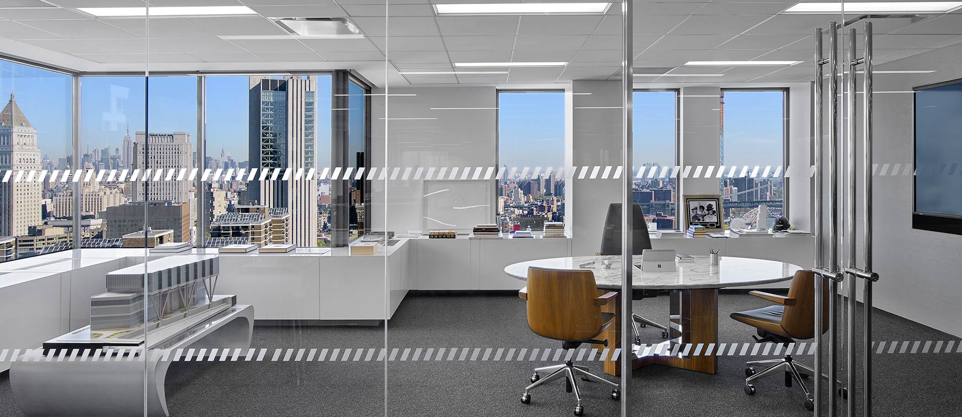 Glass wall panels create a large office front system with natural light