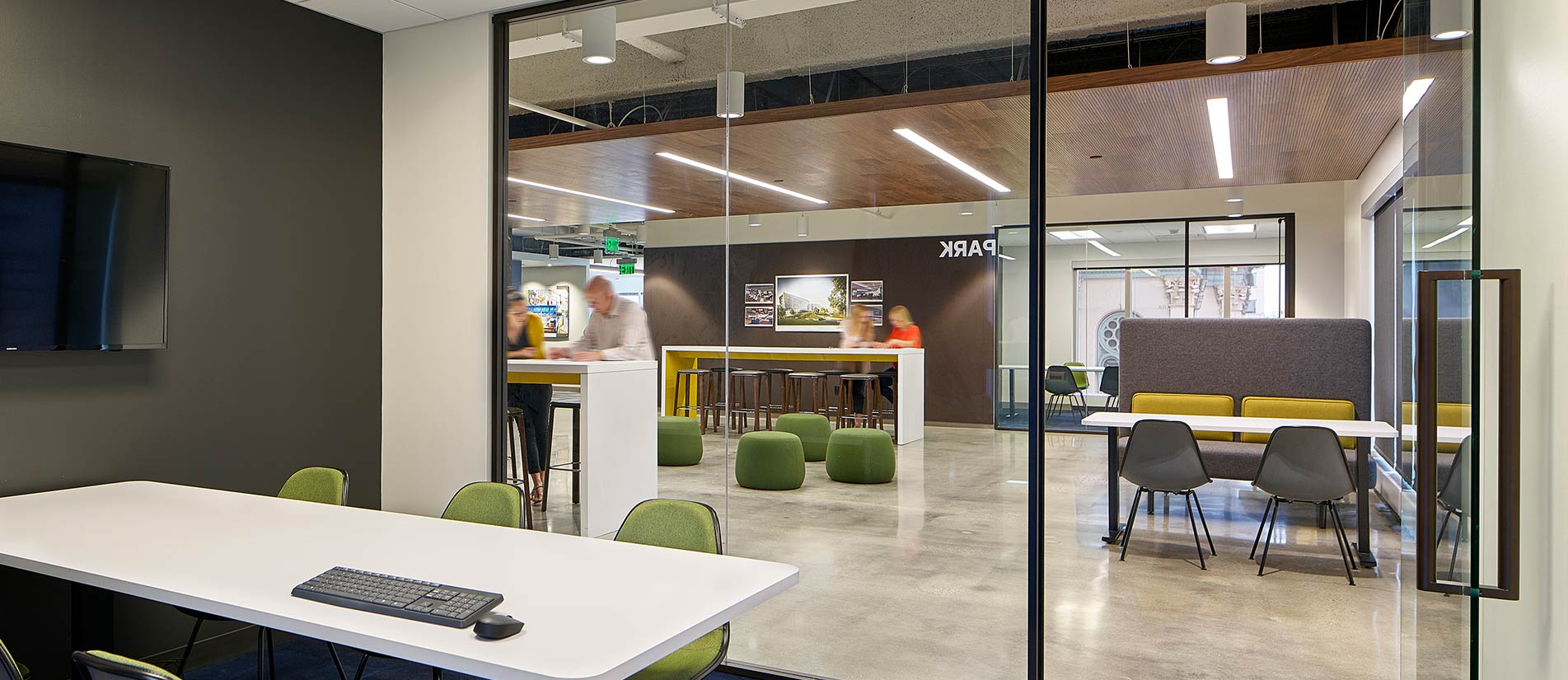 Multiple workspaces in an open floor plan are divided by One-LP movable partitions and walls.