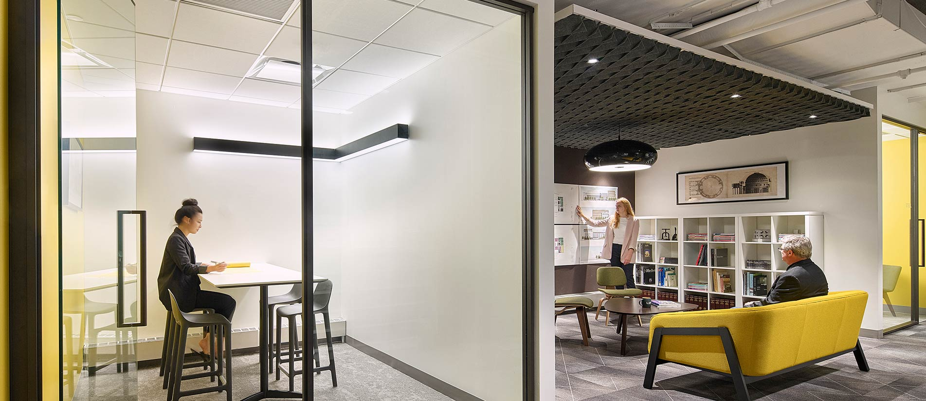 Two distinct offices, including a modern workspace and collaboration room, designed with Transwall's One-LP movable partition walls.