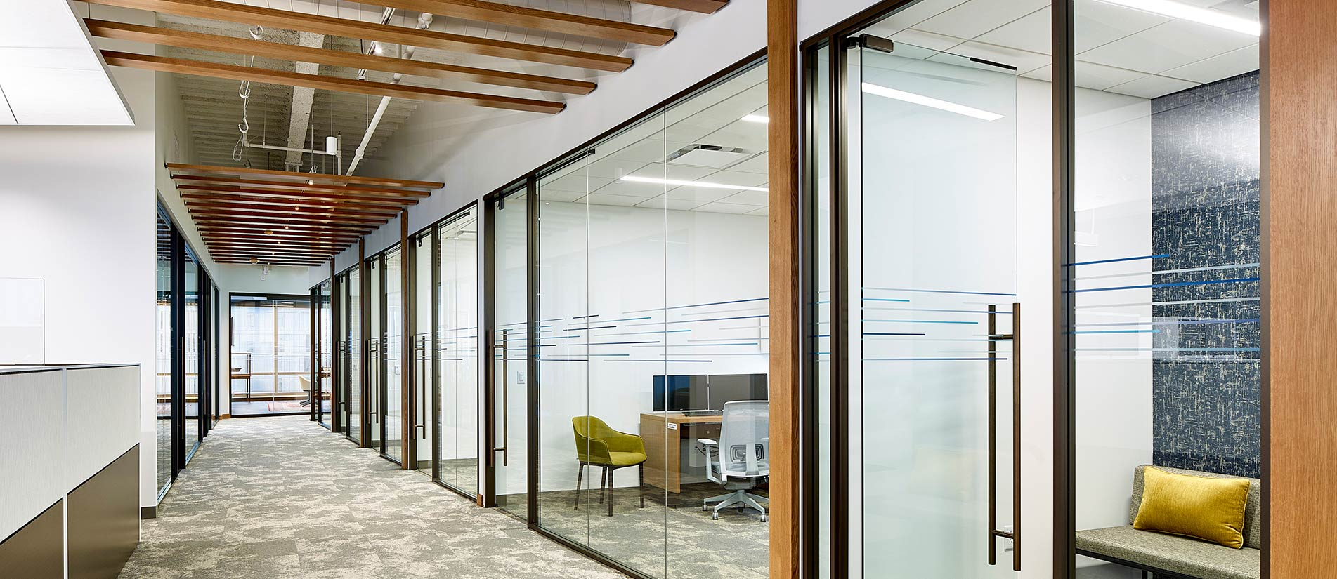 Meeting rooms and office space divided with Transwall One LP interior glass wall system