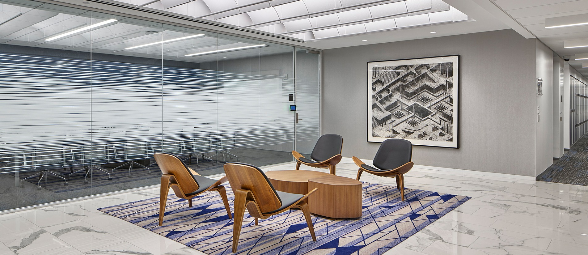 Transwall One-LP glass office wall panels create an open workspace.