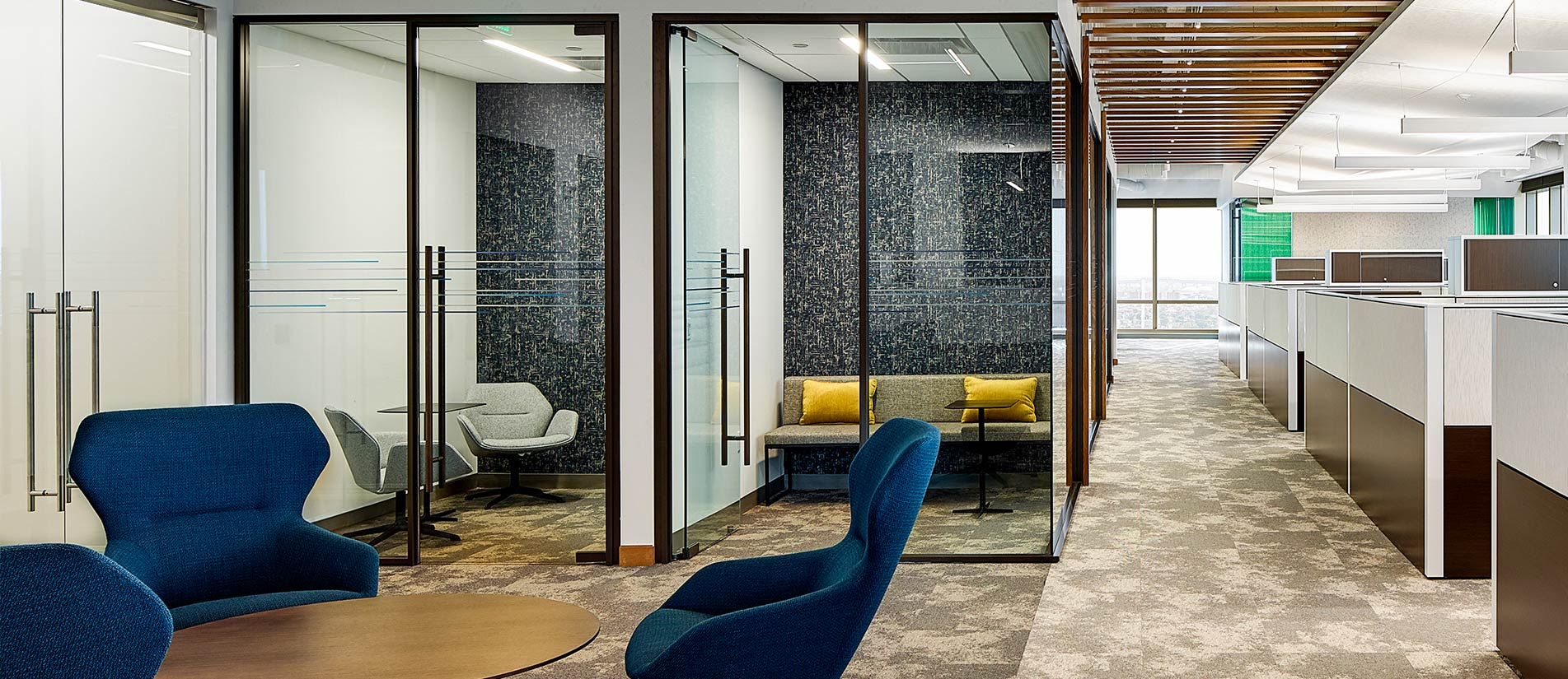 Office space divided by One LP Glass Doors and demountable wall panels